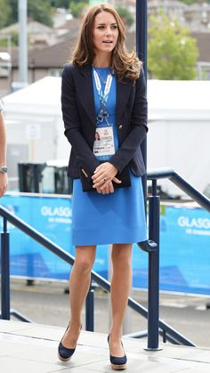 For a day at the Commonwealth Games, Catherine Middleton wore a vibrant Stella McCartney dress, navy Smythe blazer, and her favorite Stuart Weitzman wedges, July 2014