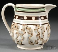 Mochaware Bag-shape Jug, Britain, c. 1820, pearlware jug with a green-glazed reeded band, black and blue slip bands, white slip dots...