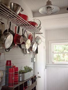 Pot rack, light fixture, beadboard