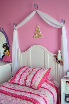 homemade canopy bed | The canopy above her bed was constructed from curtain pulls and a ...