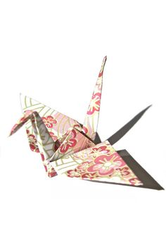 Each of the elegant Japanese paper crane is made from Japanese chiyogami paper (patterned origami paper) with graceful and exotic Japanese patterns that resemble Japanese kimono.  These paper cranes are hand folded by a Japanese woman in the special method. Unlike the paper cranes folded in the traditional method, these origami cranes do not have the lines in the middle of their wings; You get the true, beautiful attention to the detail.