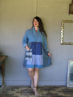 upcycled clothing patchwork denim shirt dress Aline tunic recycled Bohemian Gypsy clothing X L 1 X Wearable art Boho LillieNoraDryGoods Comfy, casual, great for all seasons............ - refashioned cropped vintage denim shirt, I can shorten sleeves, let me know at checkout - patchwork of recycled cottons bottom....... faded, frayed, tattered - added recycled frayed cotton patch pocket Colors ..............blues, khakis, reds Frayed, raw and zigzagged edges Gentle cold water wash estimate...