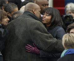 First lady Michelle Obama is greeted by her brother Craig Robinson at the ceremonial swearing-in for President Barack Obama at the U.S. Capitol during the 57th Presidential Inauguration in Washington, Monday, Jan. 21, 2013.