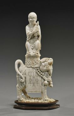 CHINESE IVORY CARVING | Antique Chinese Carved Ivory Lohan on Lion : Lot 413