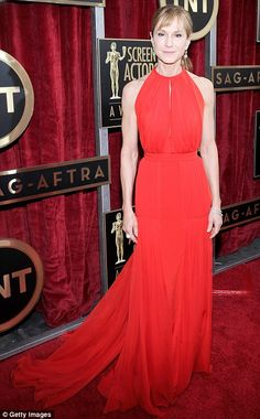 1-18-14. SAG AWARDS.  Holly Hunter showed off her impressive biceps in her halterneck Randi Rahm frock with long, flowy train