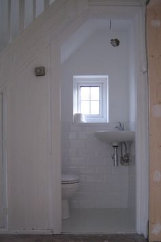 example of a small powder room under stairs. I like the very small sink Space Under Stairs, Bathroom Under Stairs, Attic Bathroom, Bathroom Layout, Basement Bathroom, Small Bathroom, Under The Stairs Toilet, Bathroom Ideas, Basement Stairs