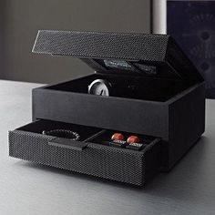 This sophisticated storage box keeps men's wallets, keys, rings, loose change, and other items handy and organized. The lid allows easy access to items used everyday. A perfect gift for graduation, Father's Day, birthdays, promotions, and more.