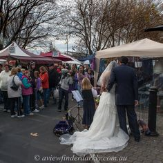 Chance encounter with a wedding photographer at work at Salamanca market. There are opportunities for interesting photographs all around you if you keep you eyes open and camera ready. More #photography tips here:  http://aviewfinderdarkly.com.au/2015/08/18/photograph-the-familiar/