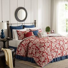The Madison Park Lucy Reversible Duvet Cover Set is perfect for those seeking a traditional and comfortable atmosphere. The beautiful bedding features a timeless floral motif in a classic red, ivory, and blue color scheme.