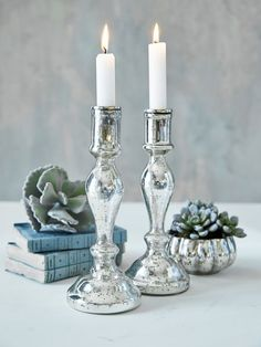 The epitome of elegance, this small mercury silver candlestick will make an opulent display on a table or mantelpiece.