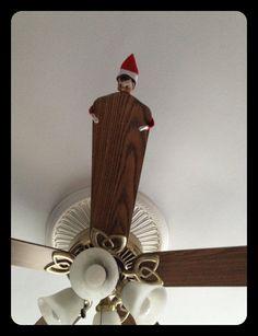 Elf on a shelf on a fan looking down