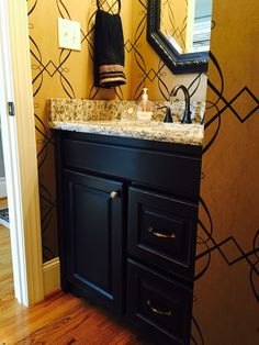 A beautiful dark wood vanity with marble countertop by Woodmaster Woodworks. Call for your FREE in-home estimate today! 919-554-3707