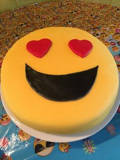 Emoji cake . Emoji birthday party . Not bad for my first time doing a cake . Now I know why people charge so much , so time consuming ! It was perfect for my 12 year old daughters birthday party . Really simple .