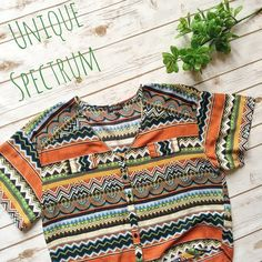 Unique Spectrum Tribal Print Festival Blouse ✨ ★ NWOT, in perfect condition.  ★ Trendy tribal design, super soft material, a perfect top for festival season! Pair with some denim shorts and you have the perfect look! ❤️ ★ 100% Rayon.  ★ NO TRADES!  ★ YES OFFERS! ✅ ★ Measurements available by request.  Tops Blouses
