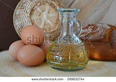 a bottle of vegetable oil, bread, eggs - stock photo