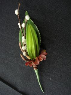 amazing ;;;Lily Bud Boutonniere    A simple closed lily bud combines with pussy willow to create this unique, textural boutonnière for a wedding. Wedding flowers created by Cindy Tole of Bontanica Flowers & Gifts in Greensboro, NC