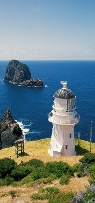 Cape Brett Lighthouse, Bay of Islands, New Zealand. The site was surveyed and chosen in 1908 by Captain John Bollons of NZGSS Hinemoa. The lighthouse was deactivated and keepers withdrawn in 1978 and replaced by an automated beacon on the same site. The Places Youll Go, Places To Visit, Lighthouse Pictures, Bay Of Islands, Beacon Of Light, New Zealand, Beautiful Places, Scenery, Around The Worlds