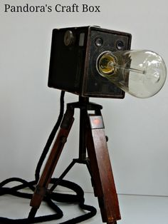 """Vintage Camera Lamps! via @Dinah Wulf {DIY Inspired}  This is an amazing idea! I've always loved the look of vintage cameras, but didn't really want to just """"collect"""" them… How great that they have been repurposed into something that can be used everyday!"""