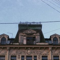 Is there someone hiding in the dark?  Sitting quietly under rooftop, breathing.  Looking on the noisy street and squeezing. Through that dusty window seeing park. #spb #poetry #building #city