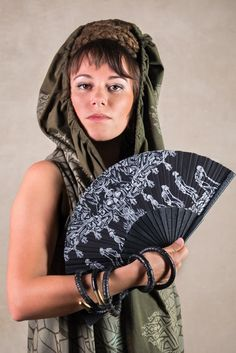 Wooden hand fan for festival wear, handcrafted down to the smallest detail, bringing into the modern styles a very special ancient accessory. Dark, daring and edgy, this folding hand fan will add a gothic touch to all your festival outfits.   Our hand fan is an amazing hand crafted artwork. The