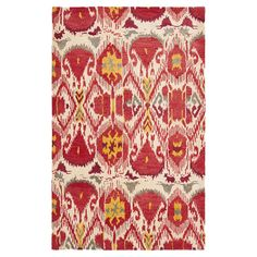 Add exotic appeal to your living room or master suite with this hand-tufted wool rug, showcasing an eye-catching ikat motif in ivory and red.