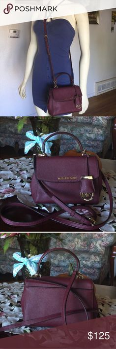 """Michael kors ava mini shoulder/crossbody bag Color:mulberry,Signature Saffiano leather ,measurement 7-1/2"""" W x 5-1/4"""" H x 3"""" D (width is measured across bottom of the handbag) Interior features 1 zip pocket and 1 slip pocket 3-1/4"""" top handle; 23-1/4""""L adjustable crossbody strap Fold-over snap closure Gold-tone hardware A stylish mini version of the full-size Ava satchel Saffiano leather; lining: poly, this bag is used with scratches on the hardware other than that its great..smoke/pet…"""