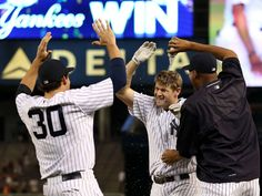 Aug. 17: Yankees third baseman Chase Headley is congratulated by teammates after grounding out allowing the winning run to score against the Minnesota Twins - © Adam Hunger, USA TODAY Sports