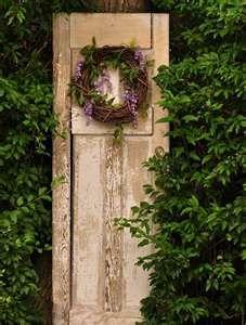 old narrow door....Tucked in the bushes