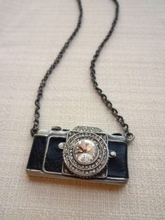 Camera necklace must say its super cute. Would be a great gift!