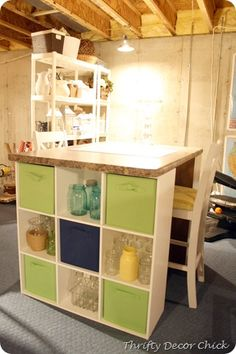 Craft table using an old countertop and Closetmaid 9 cube organizers from Thrifty Decor Chic.