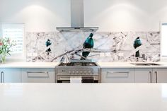 Printed image on glass kitchen splashback / backsplash by Lucy G. 'Tui Song' http://www.lucygsplashbacks.co.nzLucy works with customers all over the world.
