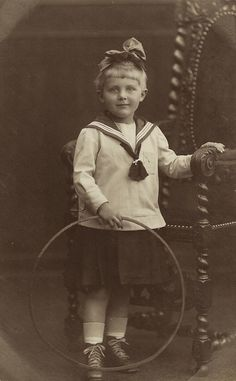 ADORABLE LITTLE GIRL AND HER TOY HOOP (VINTAGE REAL PHOTO POSTCARD)