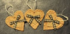 Rustic Christmas tree ornaments, toilet paper rolls, shredded, soaked, blended, and molded into hearts.