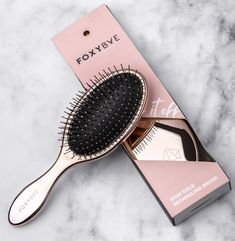 A rose gold detangling brush that'll smooth out your unruly hair with minimal pain and breakage. Bonus: it's so attractive, you can just leave it on the counter. Best Gifts Under 50, Detangling Hair Brush, Wet Brush, Rose Gold Hair, Wand Curls, Wet Hair, Professional Hairstyles, Hair Tools, Hair Hacks