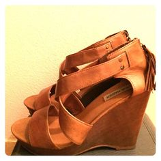"""Steve Madden Wedges Sooooooo cute!! Hate to part with them but decided they are a little high for me. Wore them a few times , great condition . They have a boho style to them with zipper and fringe in back. Wedge is wooden and about 4 1/2"""". Will pair adorable with rompers and boho dresses Steve Madden Shoes Wedges"""