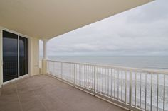 (SOLD) 1031 1ST STREET S. #706 - Beautiful sunrises from the large private covered balcony await you at one of the beaches newest highrise oceanfront buildings.  This luxurious condo features the finest upgrades.  Kitchen feature granite countertops, tile backsplash and stainless steel upgraded appliances with Subzero refrigerator.  The master suite has panoramic oceanfront views.