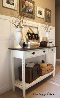 Forget the BOOK on the table - I love this table for an entry. That's how we could use our antique suitcase