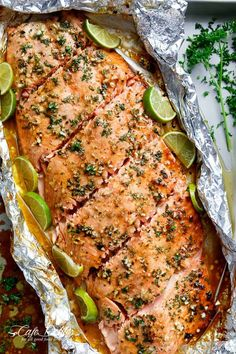 Honey Lime Garlic Butter Salmon is ready in under 30 MINUTES! Caramelized on the outside and falling apart tender on the inside. your new favourite salmon recipe is here! Honey Garlic Butter Salmon is without a doubt one Salmon In Foil Recipes, Fish Recipes, Seafood Recipes, Cooking Recipes, Healthy Recipes, Salmon Dishes, Fish Dishes, Seafood Dishes, Garlic Salmon