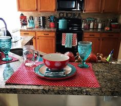 Pioneer woman inspired kitchen. Turquoise and red polka dots