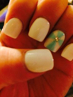 My new nails ! Got the idea from here but love these colors. white nails with Tiffany blue cross and rhinestone--Sara