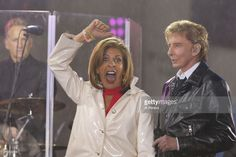NBC's 'Today' Show host Hoda Kobt interview Barry Manilow when he performs in the rain on NBC's 'Today' Show at Rockefeller Plaza on April 20, 2017 in New York City.