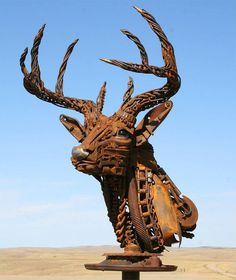 You Won't Believe What This Guy Did With Old Farm Scrap Metal. Seriously, WOW. Lots of pics to see.