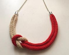Coral red and beige knitted necklace with sailor knot - Necklace made entirely by hand with the tricot technique using a cotton yarn of excellent qual - Knitted Necklace, Fabric Necklace, Knot Necklace, Fabric Jewelry, Beaded Necklace, Knitted Jewelry, Rope Jewelry, Jewelry Crafts, Jewelery
