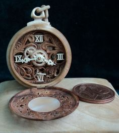 These pocket watches are made by Valery Danevich ( Валерий Даневич ) from Kiev, Ukraine. The only non-wood detail in these watches is the spring and they are fully working.