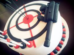 Laser Tag Themed Boy's Birthday Cake This is a cake for a Laser Tag theme with target and gun.