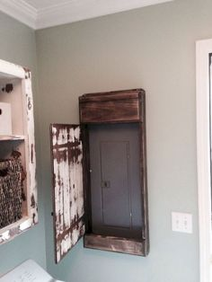 My hubby made this sweet distressed door cover for the electrical panel in our laundry room. - My Interior Design Ideas Primitive Laundry Rooms, Unfinished Basement Laundry, Dark Basement, Modern Basement, Farmhouse Laundry Room, Basement Kitchen, Basement Walls, Basement Flooring, Basement Bathroom