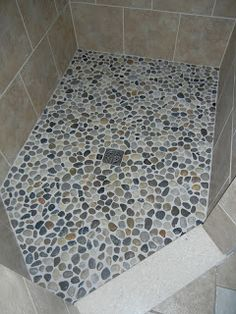 A #DIY pebble shower floor is easier than you think - if you can tile, you can make this!