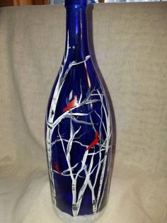 Cardinals in Birch trees hand painted on a cobalt blue wine bottle. This magnificent bottle lights up with 20 led fairy lights strung through a faux cork. The cork has an on/off switch and takes 3 batteries (included). Thanks for stopping by Liquor Bottle Crafts, Wine Bottle Art, Painted Wine Bottles, Lighted Wine Bottles, Painted Wine Glasses, Glass Bottles, Decorated Bottles, Beer Bottle, Decorate Wine Bottles