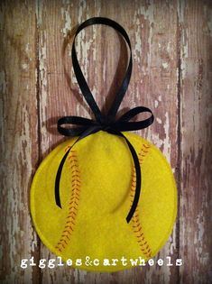 This adorable felt softball can be added as a finishing touch to your gifts, or as a tree ornament, or party favor, or simply as a cute