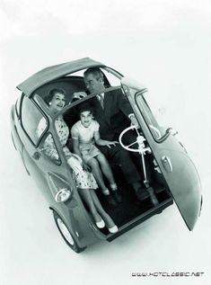 Classic Isetta bubble car from late 1950's and early 1960's. Yes they really existed and yes you got in and out by opening up the entire front of the vehicle, as improbable as that seems to anyone who has never seen one.